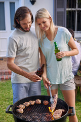Couple barbecuing