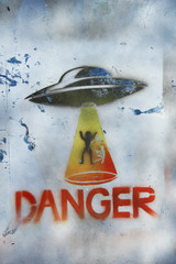 Figure abduction by aliens abstract background