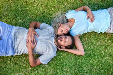 grass laying sleeping couple