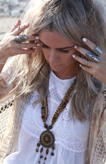 Beautiful woman wearing lots of silver rings
