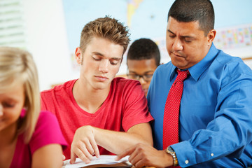 High School: Teacher Helping Frustrated Student