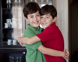 Two little boys hugging