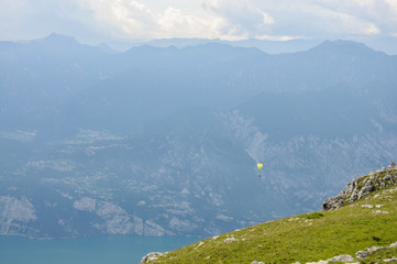 Paraglider is flying in front of mountain landscape of Alps - Mo