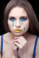 Yellow blue tears of the girl.