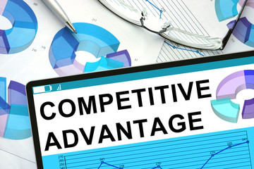 Competitive Advantage on tablet with graphs. Business concept