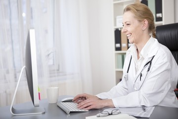 Happy Adult Woman Physician Chatting to Patients