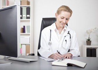 Happy Woman Doctor Making Medical Reports on Table
