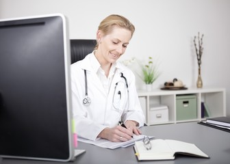 Happy Doctor Writing Medical Findings on her Table