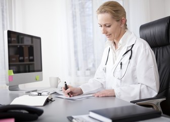 Woman Doctor Writing Findings at her Worktable