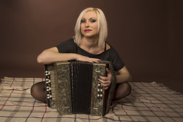 closeup portrait of young woman with an accordion