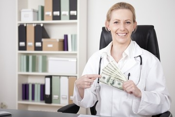 Close up Happy Woman Doctor Holding US Dollars