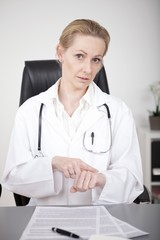 Female Doctor Showing What is the Time Gesture