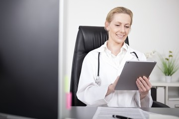 Happy Female Clinician Using her Tablet Computer