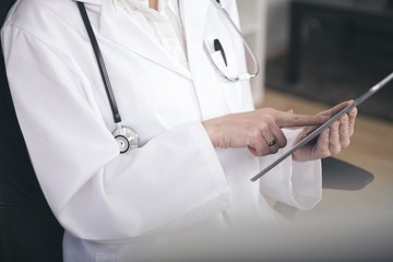 Close up Medical Doctor Using Tablet Computer