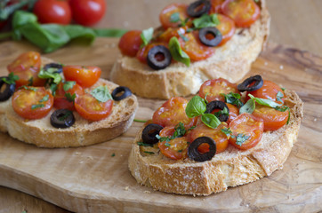 Toasts with tomatoes and olives