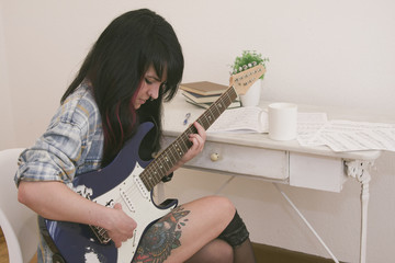 home young girl playing guitar