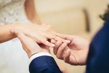"""Постер, картина, фотообои """"groom placing an engagement ring"""""""