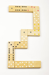 Number 2 arranged from wood dominoes tiles isolated