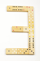 Number 3 arranged from wood dominoes tiles isolated