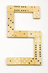 Number 5 arranged from wood dominoes tiles isolated