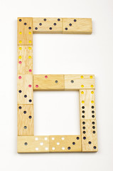 Number 6 arranged from wood dominoes tiles isolated