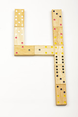 Number 4 arranged from wood dominoes tiles isolated