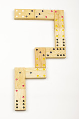 Number 7 arranged from wood dominoes tiles isolated