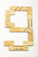 Number 9 arranged from wood dominoes tiles isolated
