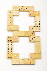 Number 8 arranged from wood dominoes tiles isolated