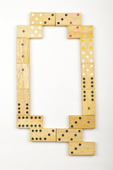 Alphabet letter Q arranged from wood dominoes tiles isolated
