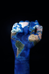 raised fist patterned with a world map (furnished by NASA)