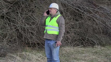 Forest engineerS with cell phone andtablet PC