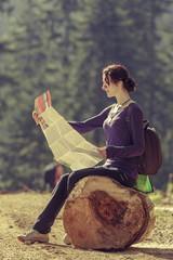 Lady reading travel map