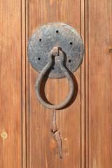 Old rusty door knocker closeup. vertical