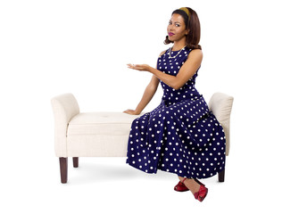 young black female on a chaise lounge with advertising gesture