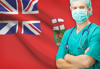 Surgeon with Canadian privinces flag on background - Manitoba