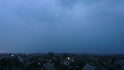 Thunderstorm over the city at night. Timelapse