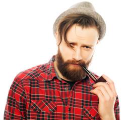 Bearded man smoking a pipe