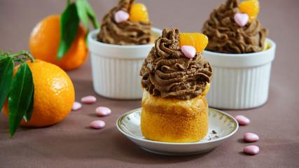 cupcakes with chocolate cream with fresh tangerine