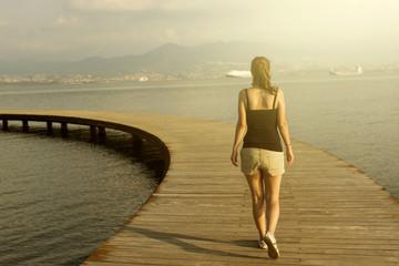 Woman walking on pier