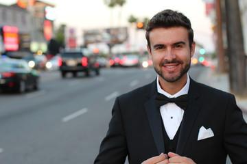 ortrait of handsome stylish man in elegant black suit