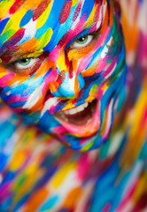 Portrait of the bright beautiful girl with art colorful make-up