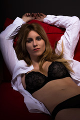 Seducing woman lying on sofa