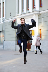 man jumping for joy.