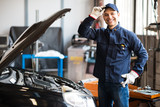 Portrait of a mechanic at work in his garage - 81896800