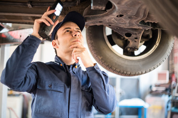 Mechanic inspecting a car
