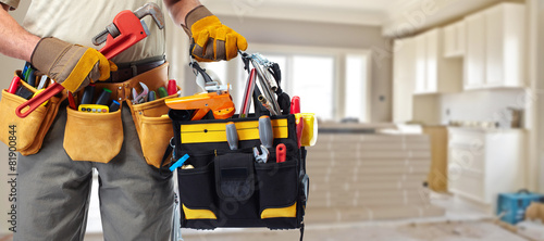 Builder handyman with construction tools. - 81900844