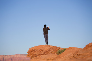 Man taking a photograph or a selfie, taking pictures, on a mount