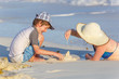 Family making sand castle at the beach