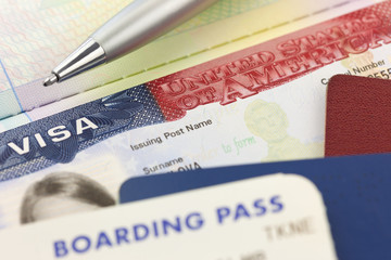 USA Visa, passports, boarding pass and pen - foreign travel